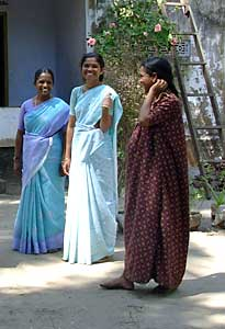 Staff Members Visiting a Family