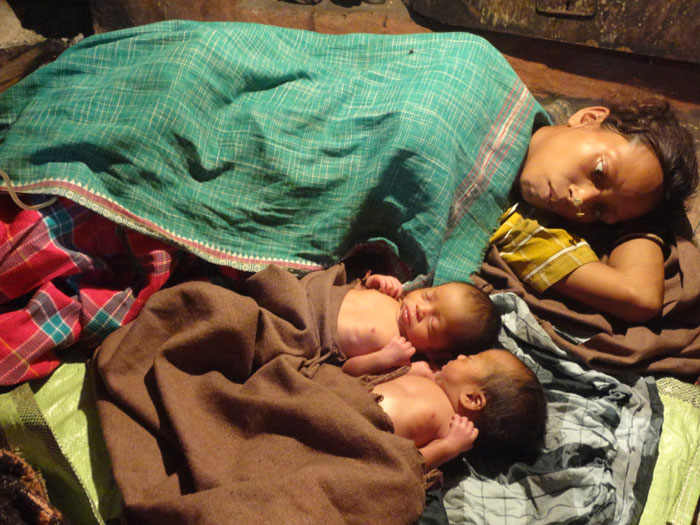 Mother lying with newborn twins